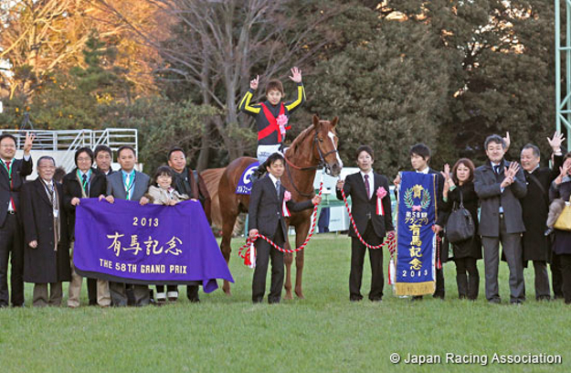 Orfevre and owners Sunday Racing Co. Ltd. in the winner's circle after the 2013 Arima Kinen. Photo: Japan Racing Association.