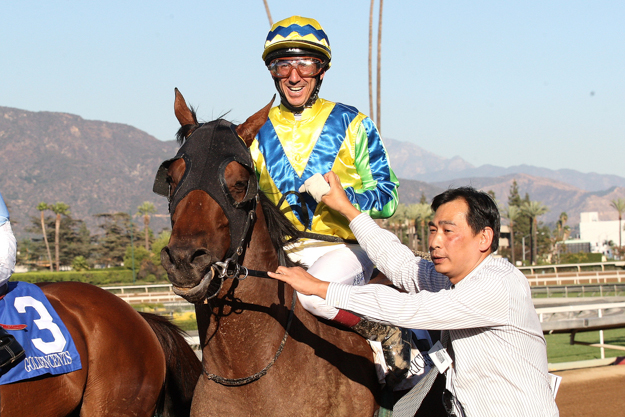 Jockey Olivier Doleuze and trainer Michael Chang after Rich Tapestry's win in the G1 Santa Anita Sprint Championship. Photo: Benoit Photo.