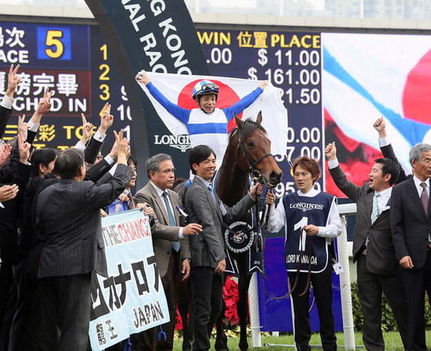 Jockey Yasunari Iwata and representatives of Lord Horse Club celebrate Lord Kanaloa's win in the 2013 LONGINES Hong Kong Sprint. Photo: The Hong Kong Jockey Club.