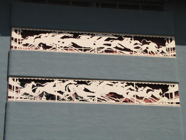 A lively punched metal frieze runs across the grandstand rear façade. Photo: Joshua Smelser.