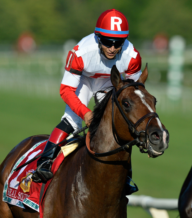 Real Solution and jockey Alan Garcia in the 2013 Arlington Million. Photo: AP/Brian Kersey.