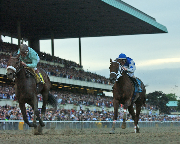 Birdstone runs by Smarty Jones in the 2004 Belmont Stakes. Photo: NYRA/Adam Coglianese.