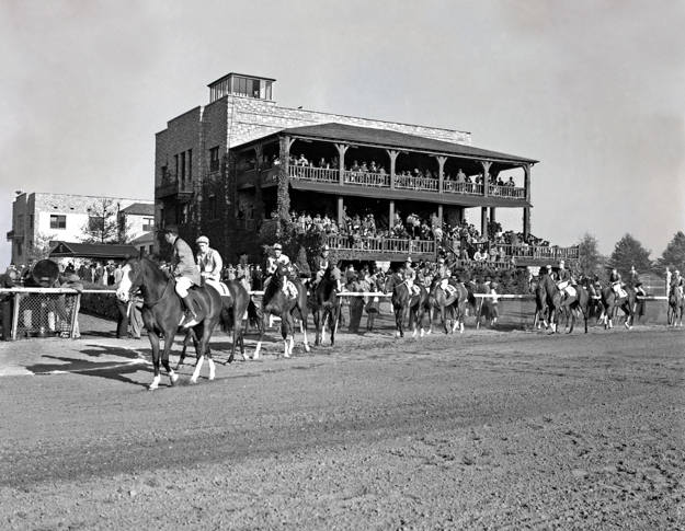 Horses parading on the track in front of the Keeneland clubhouse, circa 1940. Photo: Keeneland Library.