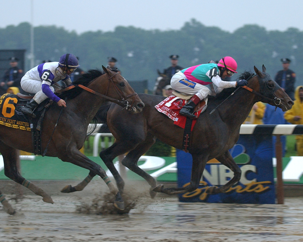 Empire Maker defeats Ten Most Wanted and Funny Cide in the 2003 Belmont Stakes. Photo: NYRA/Adam Coglianese.