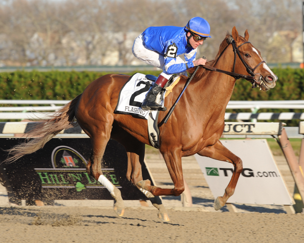 Richard Migliore and Flashing win the 2009 G1 Gazelle Stakes at Aqueduct. Photo: NYRA/David Alcosser.