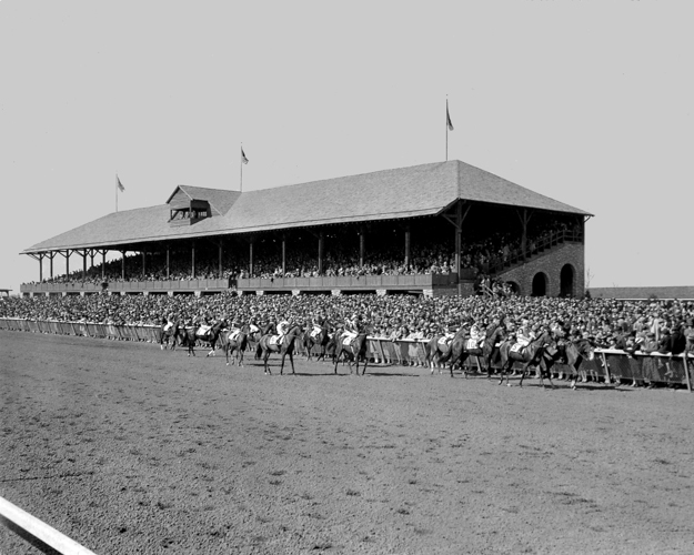 Grandstand, photographed in 1939, shared the same limestone, timber, and slate palette of materials as the clubhouse. Photo: Keeneland Library.