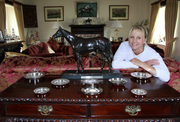 Ann Duffield at her home with a statue of Alborada who was ridden by George and won back-to-back G1 Champion Stakes in 1998 and 1999. Photo: John Gilmore.