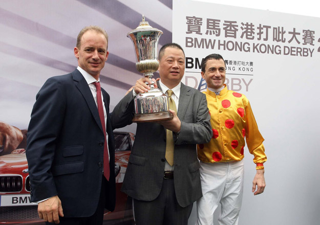 Left to right: Richard Gibson, Pan Sutong, and jockey Douglas Whyte after winning the 2013 Hong Kong Derby with Akeed Mofeed. Photo: HKJC