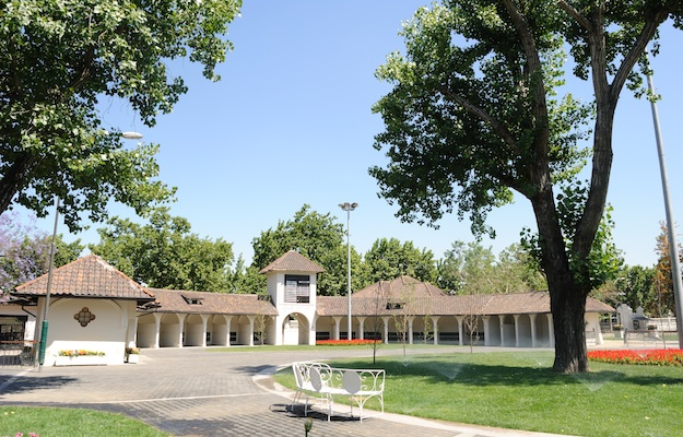 The paddock, with Mission Revival-style saddling stalls. Photo via Isabelle Taylor