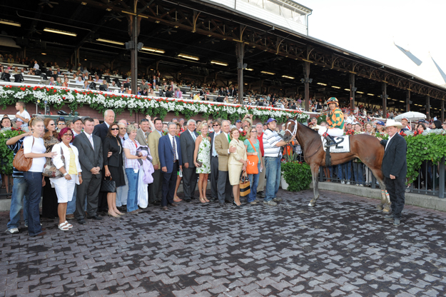 Brereton Jones-owned Proud Spell in the winner's circle at Saratoga Race Track after taking the Alabama Stakes. Photo: NYRA/Adam Coglianese.