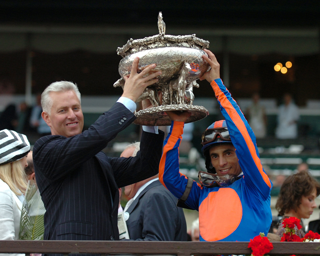 John Velazquez and trainer Todd Pletcher hold up the trophy after winning the 2007 Belmont Stakes with Rags To Ritches. Photo: NYRA/Adam Coglianese.