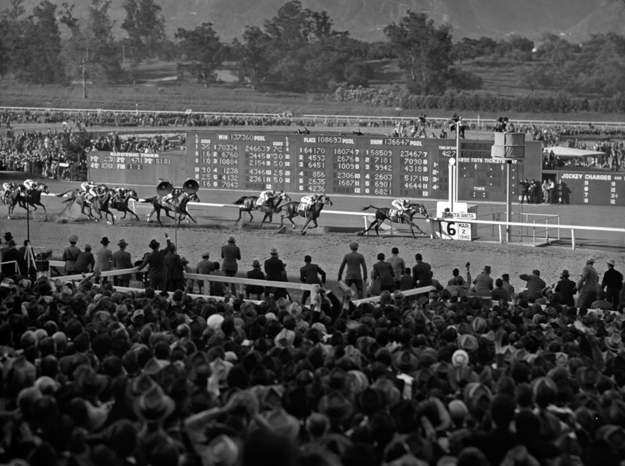 The Library frequently receives requests for copies of photographs from its collections. This photo by Bert Morgan captures Seabiscuit winning the 1940 Santa Anita Handicap. Photo via Keeneland Library/Morgan Collection.