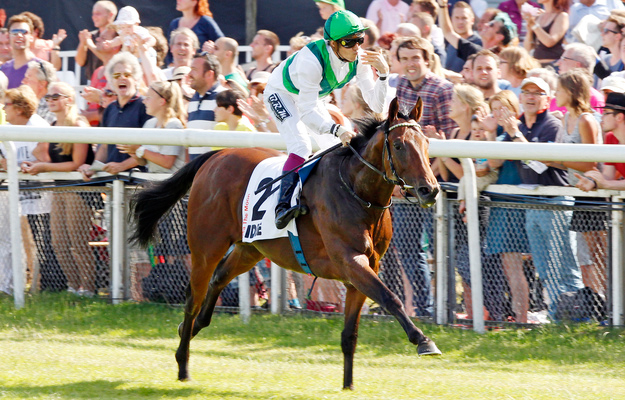 Sea The Moon, Christophe Soumillion up, after winning the German Derby. Photo: RacingFotos.com