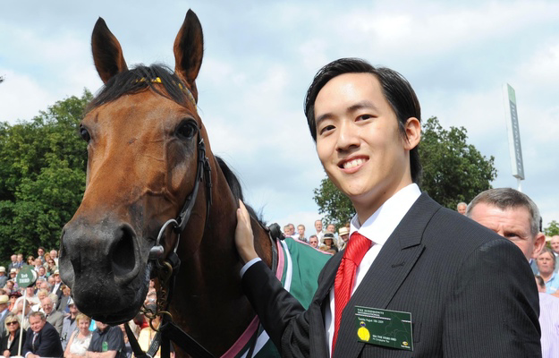 Christopher Tsui and Sea The Stars after winning the Juddmonte International Stakes at York. RacingFotos.com