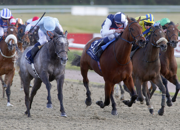 Grandeur (the grey) and Ryan Moore winning the Coral Easter Classic at the All-Weather Championships at Lingfield Park on April 18. RacingFotos.com