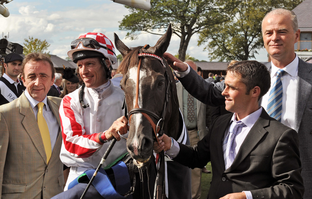 Sole Power with trainer Eddie Lynam, and jockey Richard Hughes. RacingFotos.com