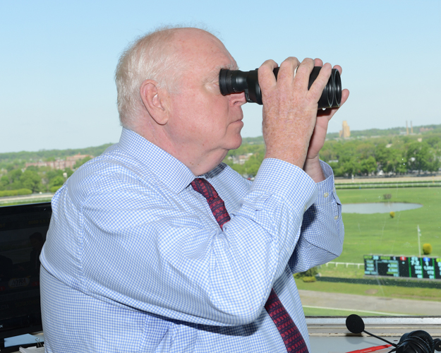Tom Durkin looks out over the Belmont track. Photo: NYRA/Adam Coglianese.