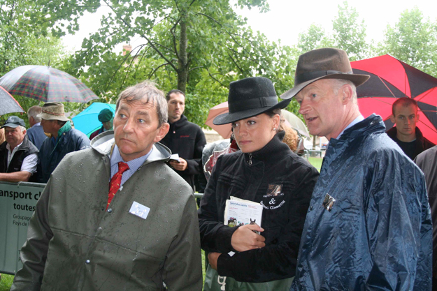 Ferdy Murphy, FRBC's Capucine Houel, and Willie Mullins (left to right), challenging the rain to deliver their judgement at the 2011 Decize show‏. Photo: Laurence Salphati.