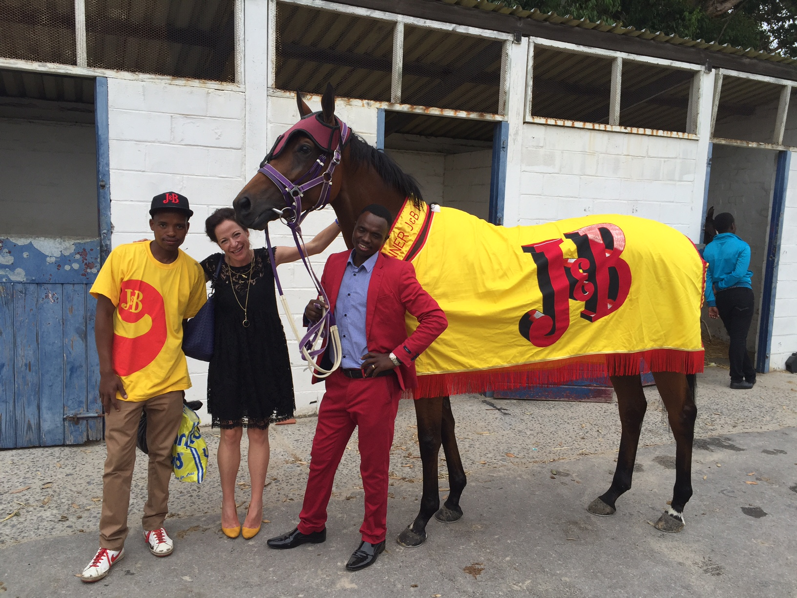 Smart team: Bangeli Mngeni (red suit), Jessica Slack and groom Akona Mqanda with Smart Call after her J&B Met victory. Photo: Mauritzfontein Stud