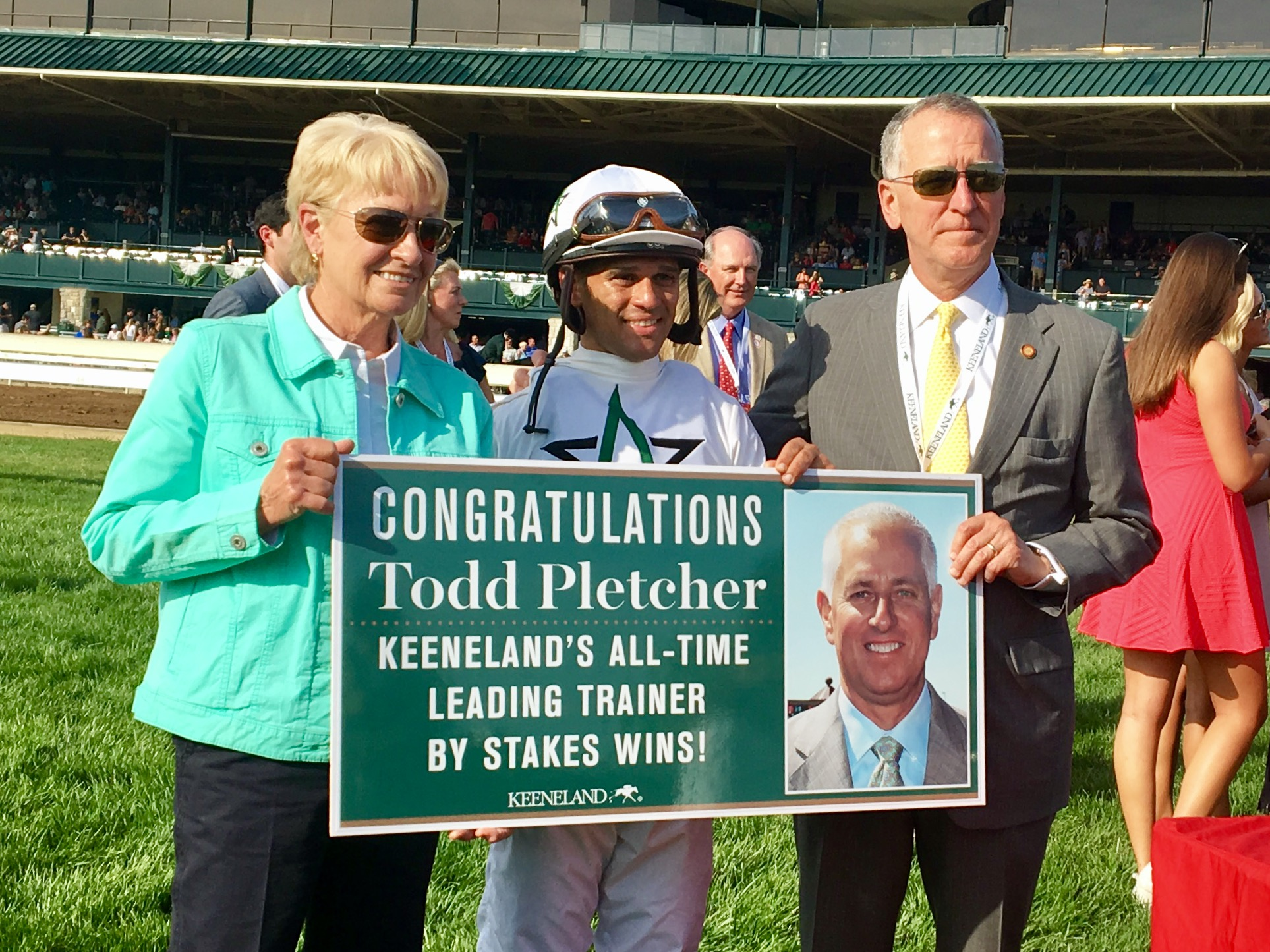 Ginny DePasquale with Javier Castellano and Todd Pletcher and the Keeneland placard. Photo: Keeneland/Coady Photography