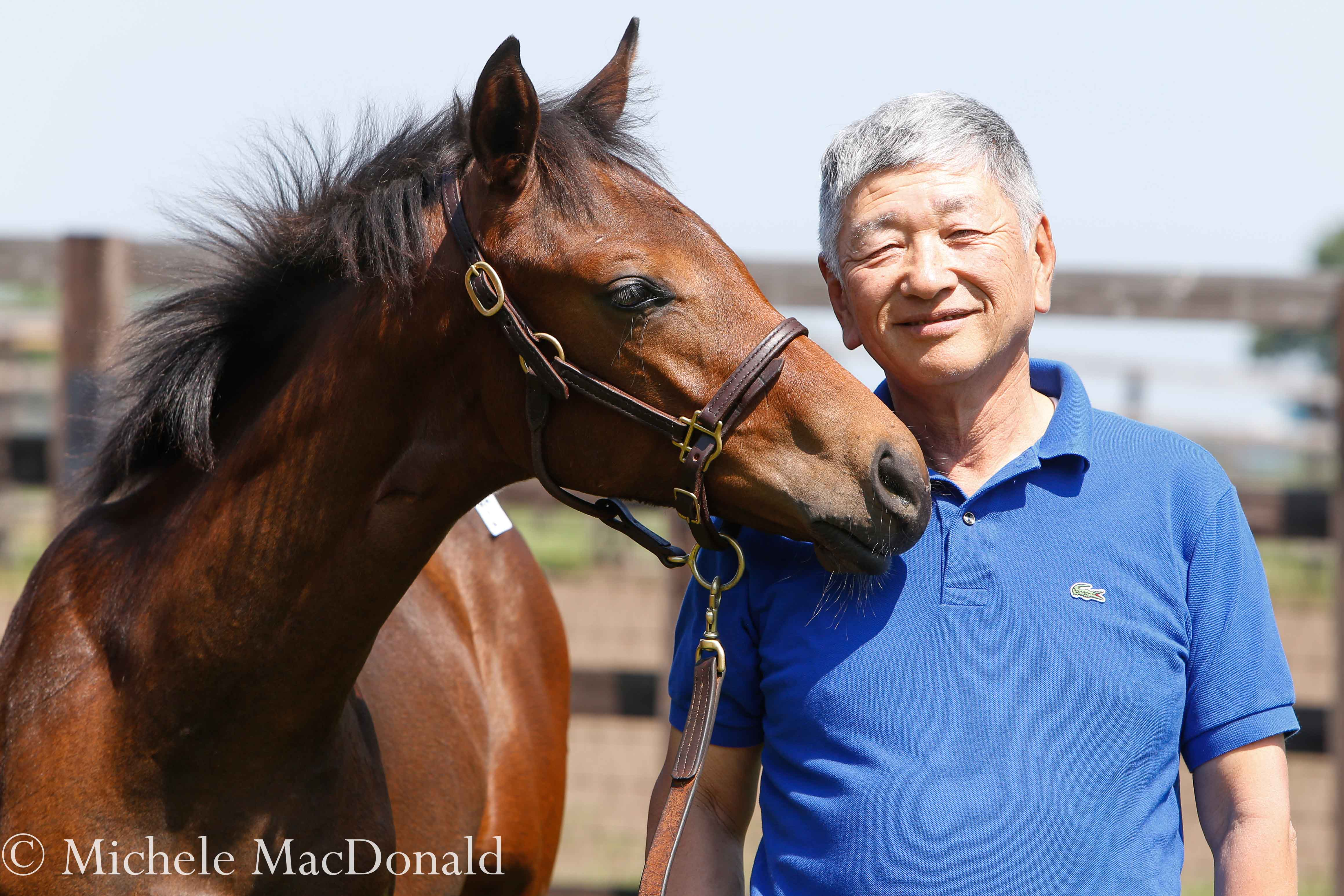 Proud consignor: Teruya Yoshida with a Kizuna colt out of Feodora consigned by his Shadai Farm. The foal went to Shinji Maeda for the equivalent of $789,000. Photo: Michele MacDonald