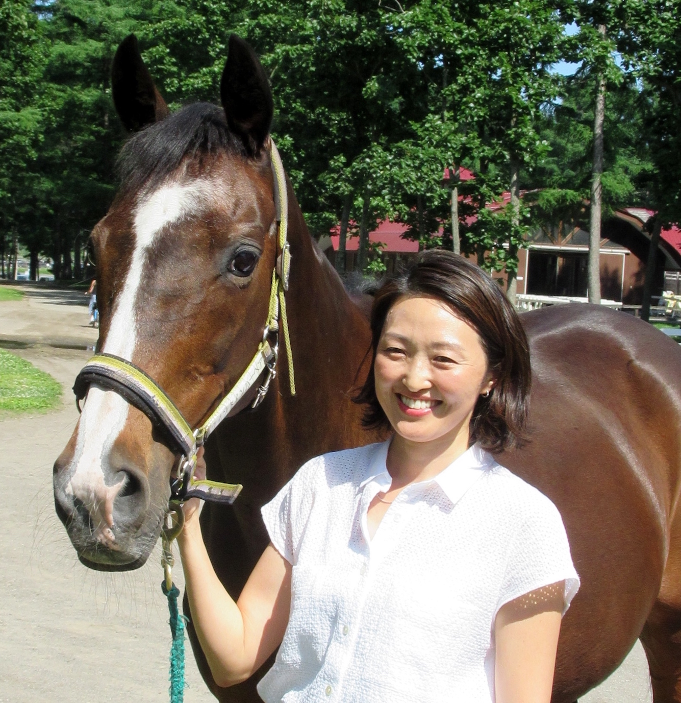 Sharing the family treasure: Wind In Her Hair, dam of Deep Impact, is popular with visitors to Northern Horse Park. She is pictured there with Akiko Yonemoto, NHP director and daughter of its founder, Katsumi Yoshida. Photo: Amanda Duckworth
