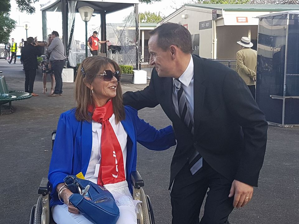 """I am the luckiest person on course today."" Carolyn Nutt with Winx's trainer, Chris Waller, at Moonee Valley on Saturday. Photo: Kristen Manning"