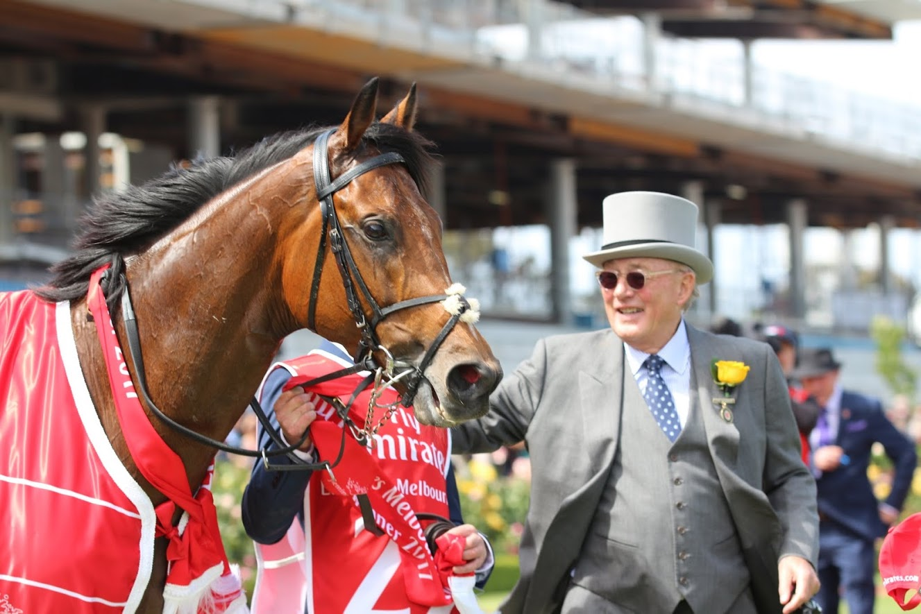 Melbourne Cup winner Rekindling, by some way the youngest horse in the race, with owner Lloyd Williams. Photo: Kristen Manning