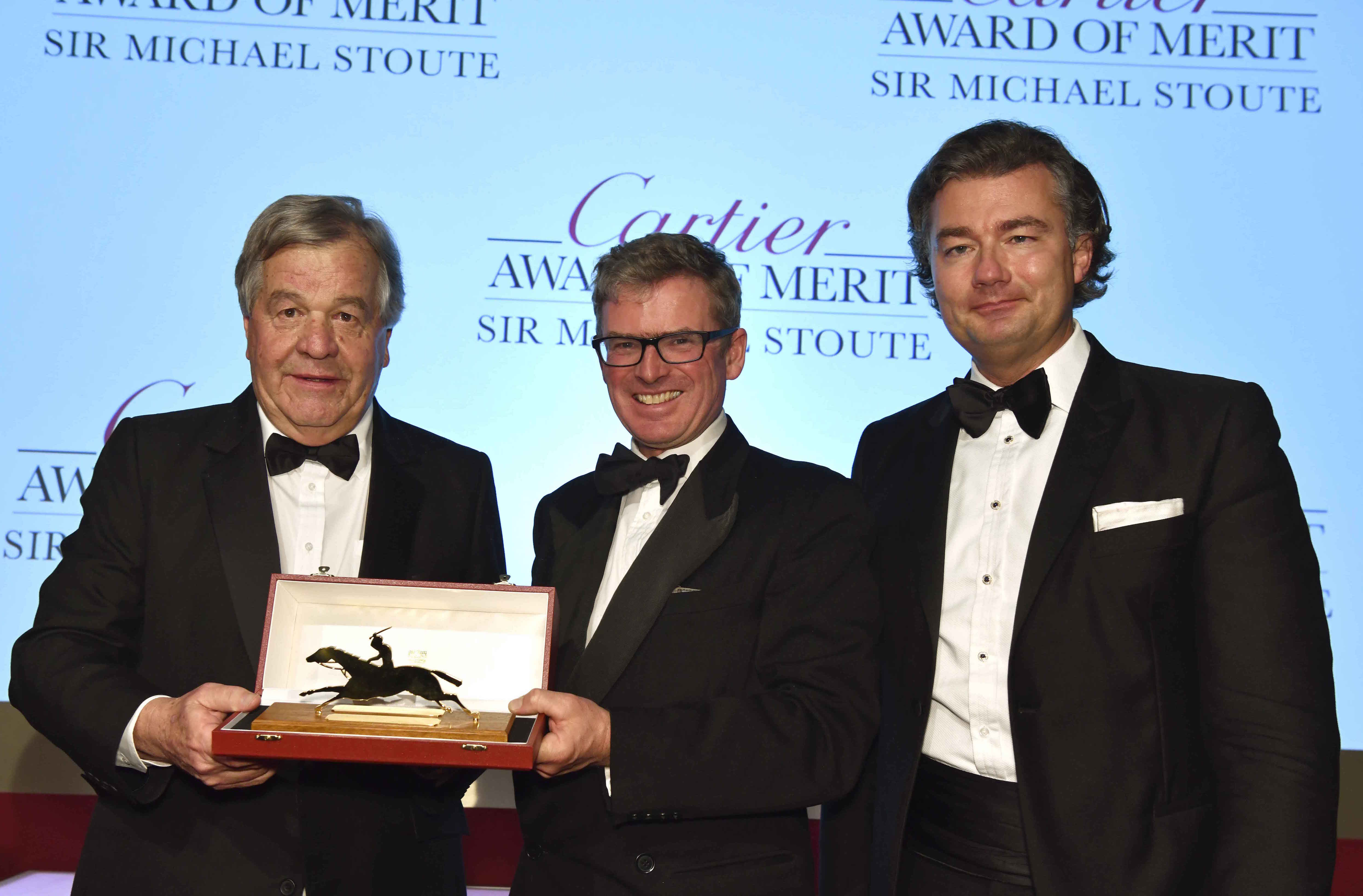 Stoute receives the Merit Award from Daily Telegraph racing writer Marcus Armytage (centre) and Cartier managing director Laurent Feniou. Photo: Tim Griffiths