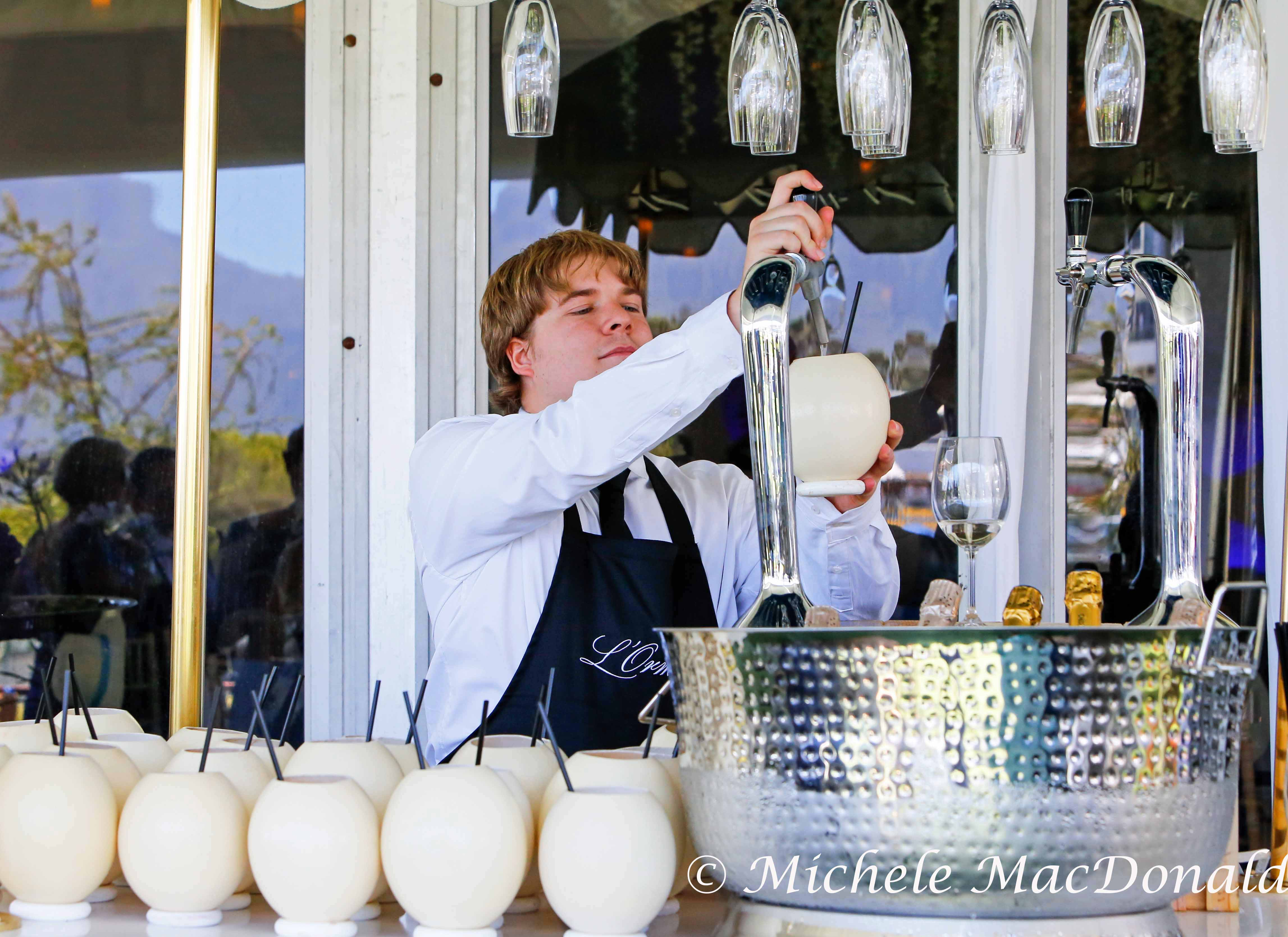 Champagne cocktails served in hollowed out ostrich eggs help fuel the intensity of fun. Photo: Michele MacDonald