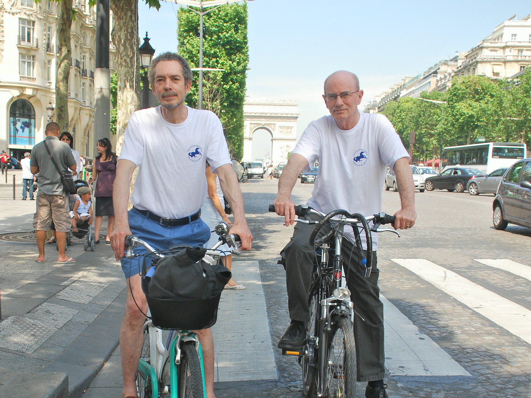 Intrepid duo: Cramer (right) with Alan Kennedy on the Champs Elysees in Paris during their marathon charity bike ride. Photo: John Gilmore