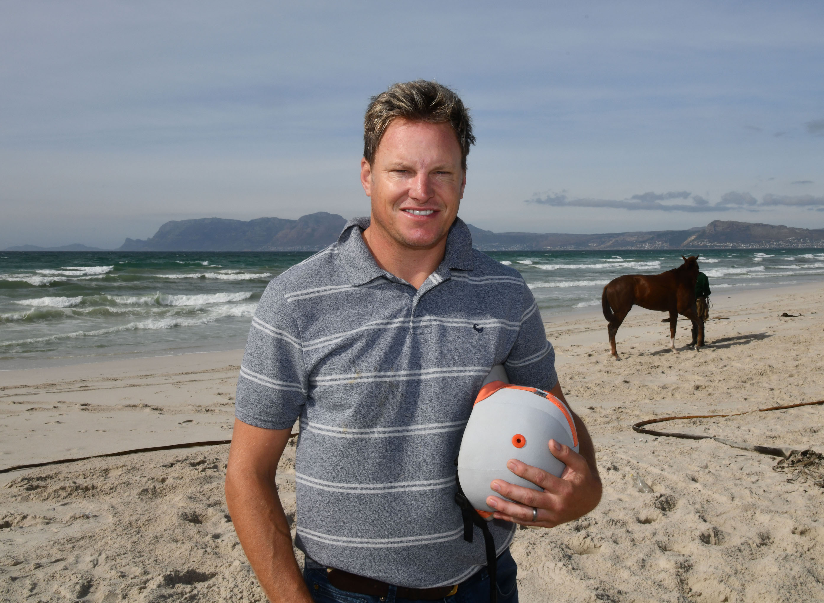 "Trainer Justin Snaith with his string on the beach at Cape Town: ""If I see a race anywhere in the world and my horse is good enough, I'd like to be there,"" he says. Photo: Hugh Routledge"