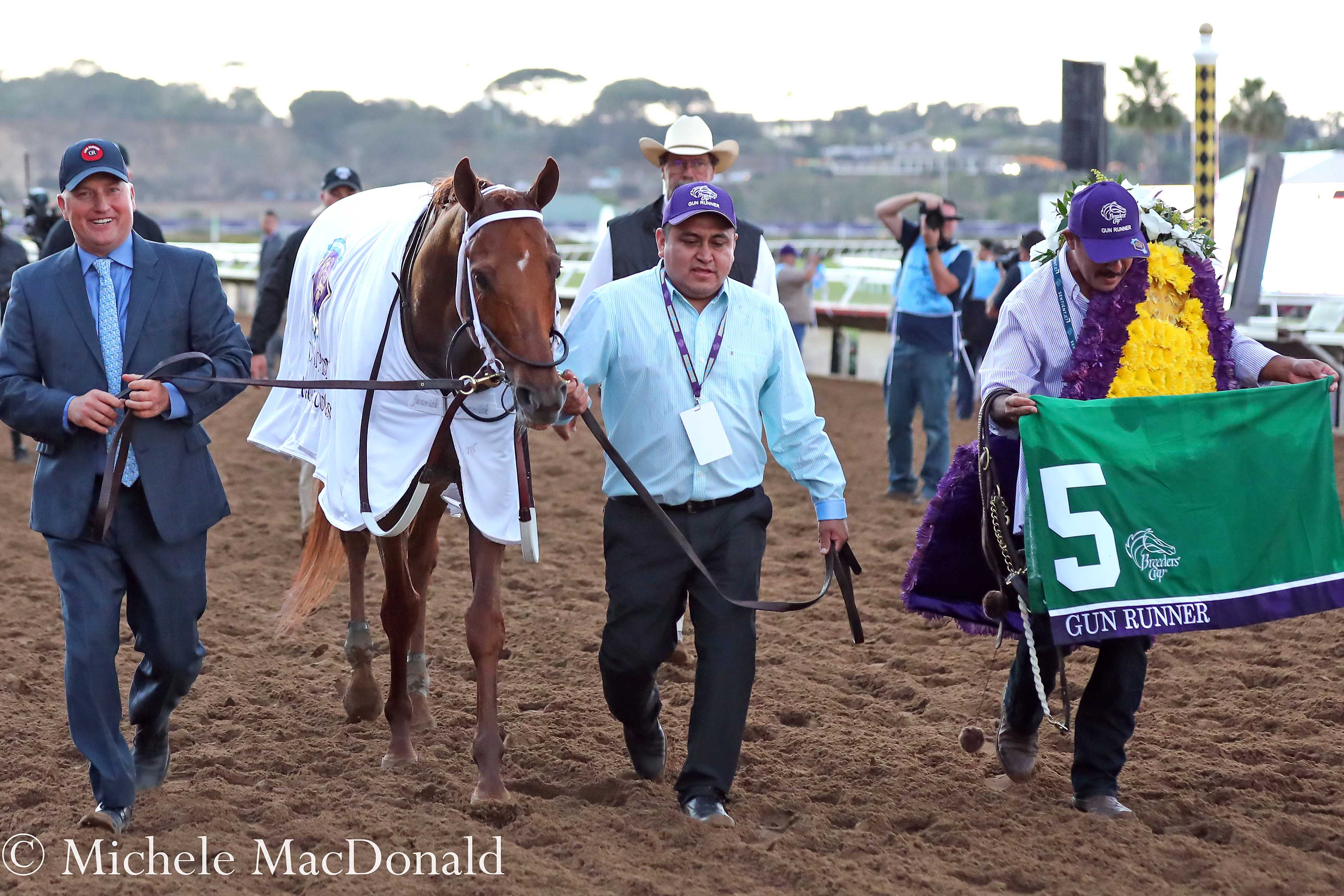 """How Gun Runner recovered from [the Dubai World Cup] was pretty special — and a sign that there were, perhaps, better things to come,"" says chief assistant trainer Scott Blasi, pictured on the left with Gun Runner after the BC Classic. Photo: Michele MacDonald"
