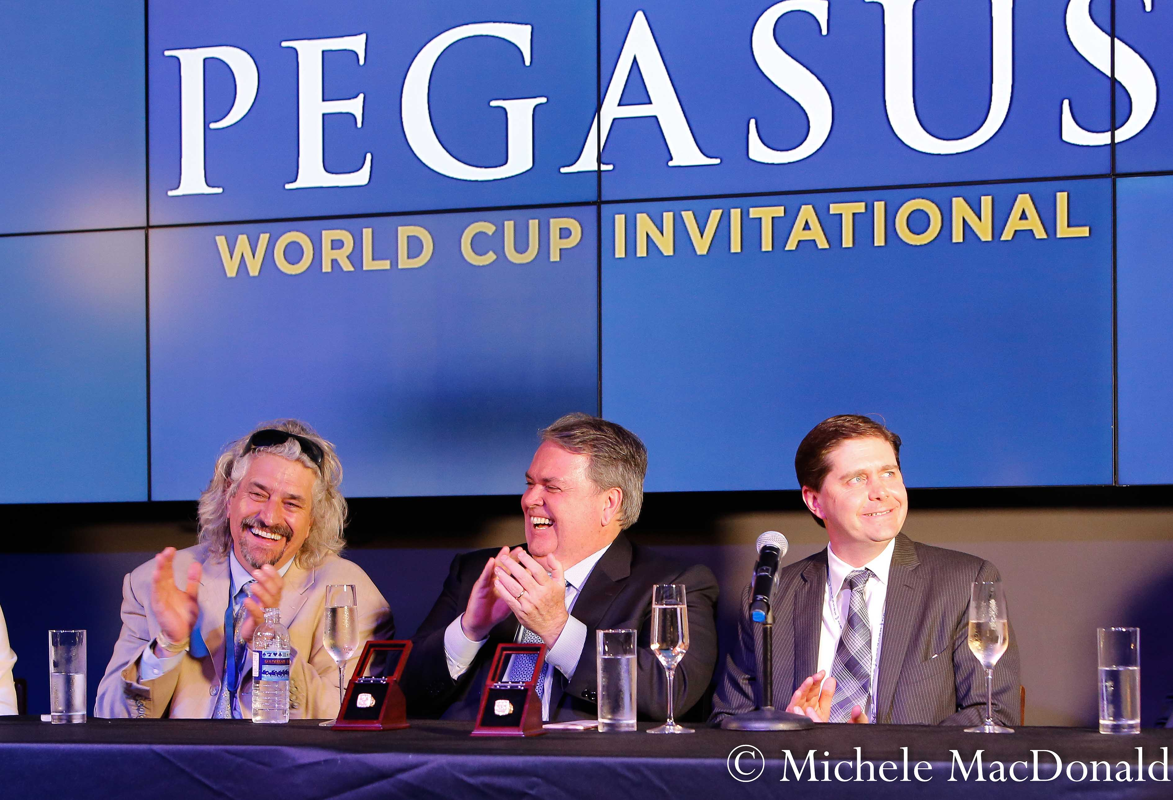 Bittersweet ending: Gun Runner's trainer Steve Asmussen with owners Goncalo Torrealba of Three Chimneys (center) and Ron Winchell at the post-race press conference. Photo: Michele MacDonald