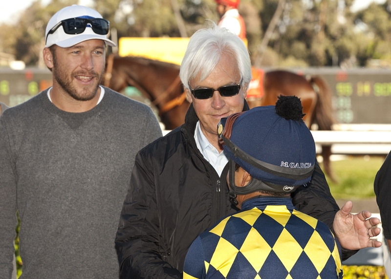 Winning owner: Bode Miller with Bob Baffert and jockey Martin Garcia after Carving, which he owned in partnership with Baffert's wife, won at Hollywood Park in 2012. Benoit photo