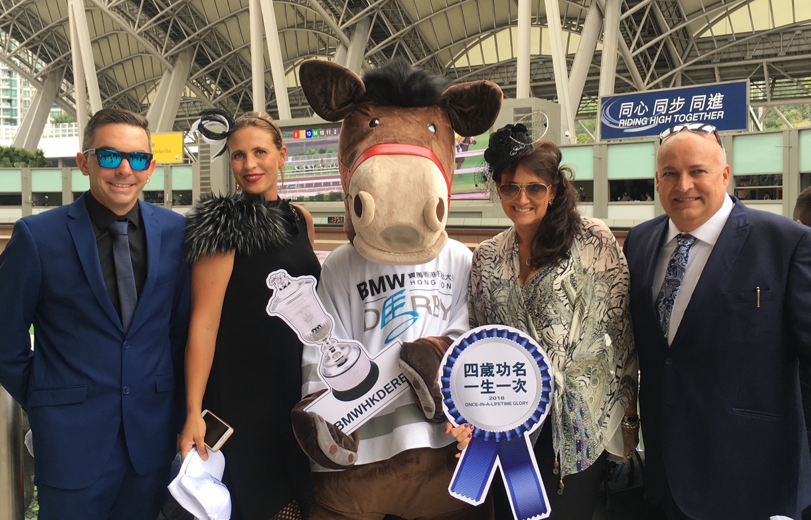 Highden's Sam and Libby Bleakley (left) and breeders Lisa and Glenn Morton on track at Sha Tin to watch Ping Hai Star win the Hong Kong Derby