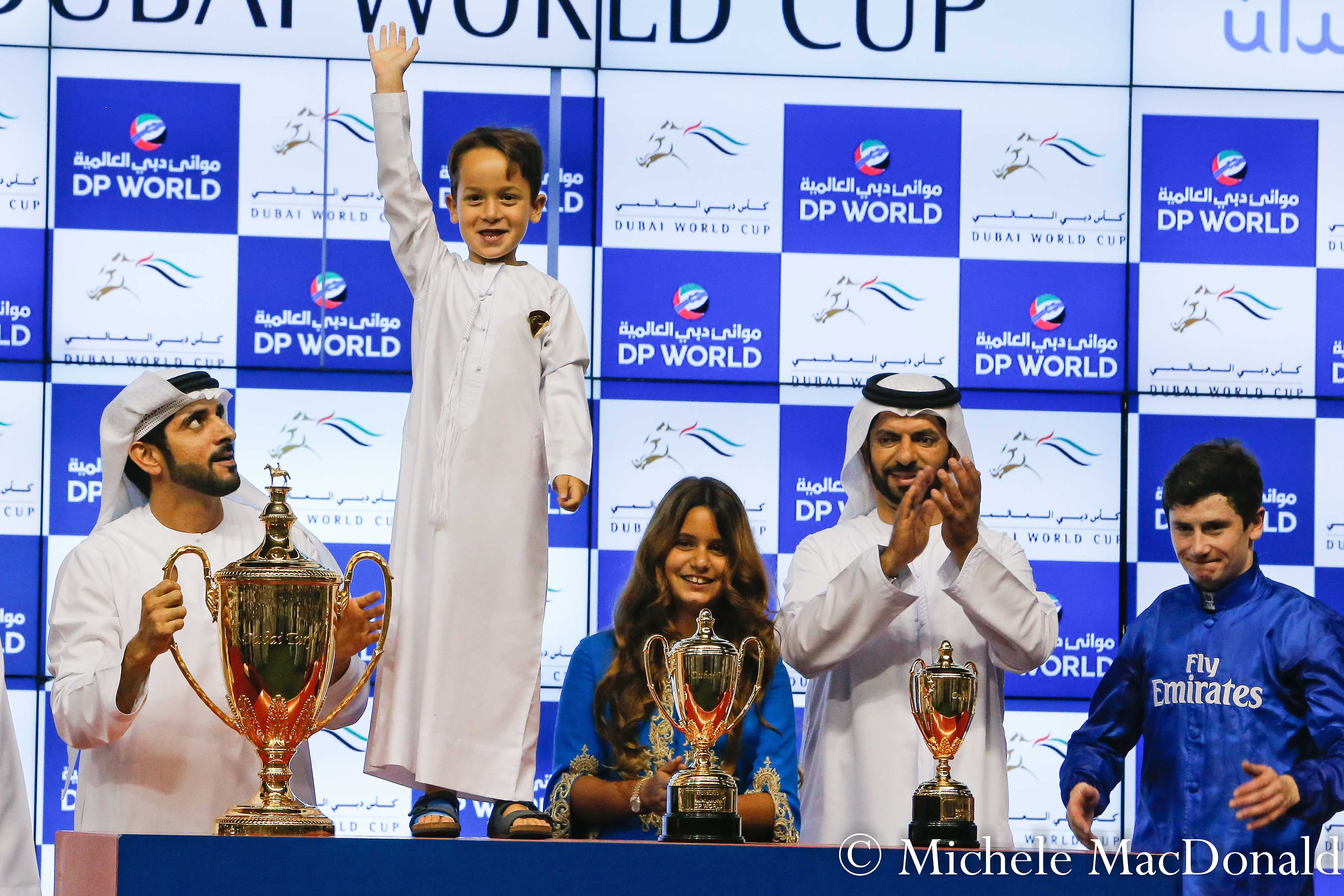 Benbatl's Dubai Turf was the first of two huge wins on the night for Saeed Bin Suroor's team. Here with the trophy are Crown Prince Sheikh Hamdan bin Mohammed al Maktoum with the young son of Sheikh Mohammed and Princess Haya, Sheikh Zayed, standing on the table next to their daughter, Al Jalila, and Saeed Bin Suroor and  jockey Oisin Murphy. Photo: Michele MacDonald