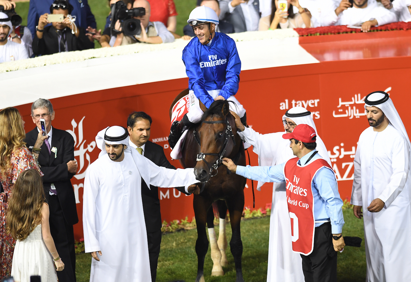 Christophe Soumillon enjoys the moment as Thunder Snow is feted in the winners' enclosure after the race. Saeed Bin Suroor is on the right. Photo: Dubai Racing Club