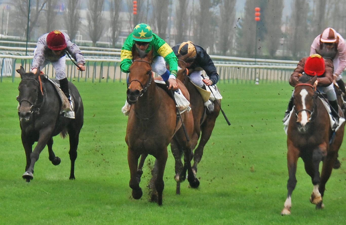 Coeur de Beaute (green colours) takes up the running close home on her way to victory in the G3 Prix Imprudence at Deauville last month. Photo: John Gilmore