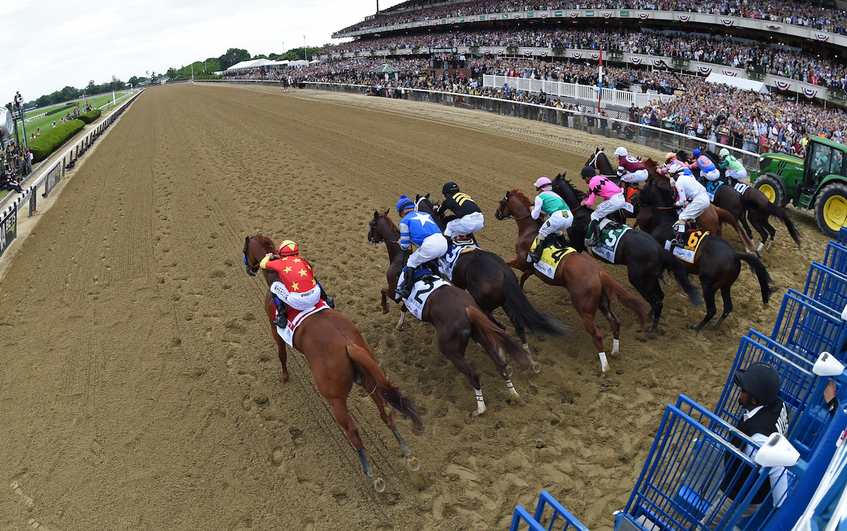 Go for it: Mike Smith galvanizes Justify (left) as soon as the gates open, rushing him up the inside and straight into the lead. Photo: Adam Mooshian/NYRA.com