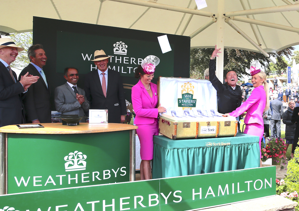 Presentation time: Frankie Dettori and the £1 million with, from left, Weatherbys Hamilton CEO Charles Hamilton, WH chairman Roger Weatherby (who is also Senior Steward of the Jockey Club), and Stradivarius' groom, Surinder Parmar, and trainer, John Gosden. Photo: Weatherbys Hamilton