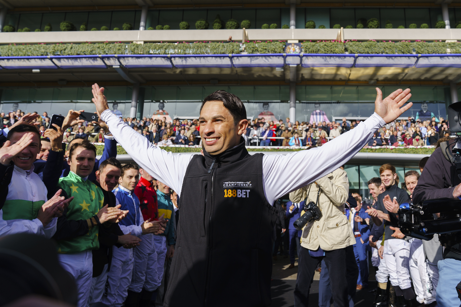 Hail a hero: the crowd - and a guard of honour from his fellow jockeys - saluting 2017 champion Silvestre De Sousa on Qipco British Champions Day. De Sousa is sure to retain his crown this season
