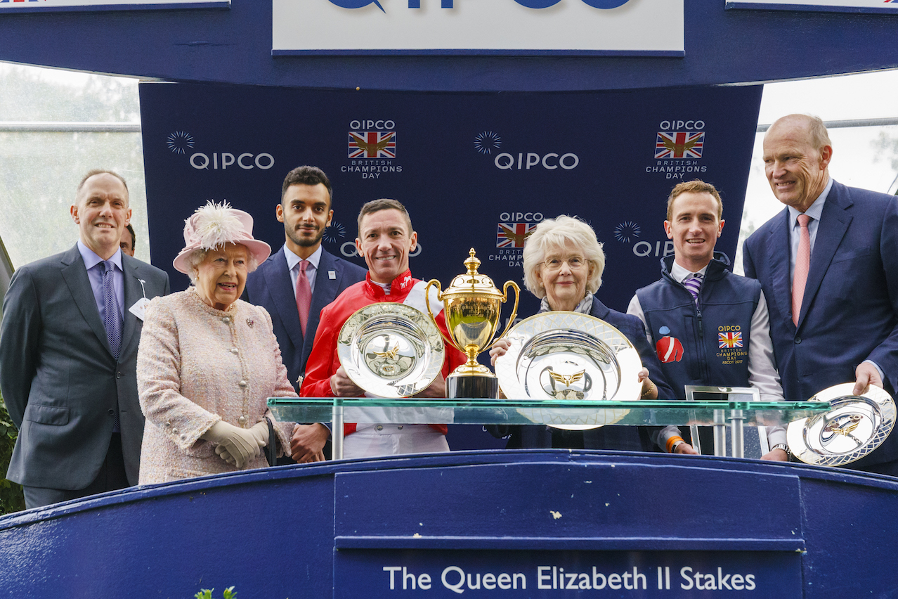 Royal seal of approval: The Queen has been present at every Qipco British Champions Day so far. She is pictured with connections of Persuasive, winner of the Queen Elizabeth II Stakes at last year's meeting