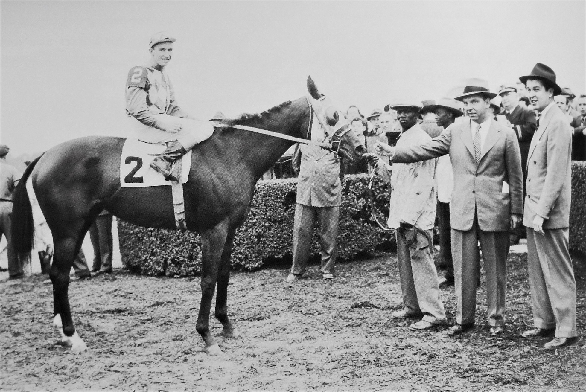 Bed o' Roses with jockey Eric Guerin, trainer Bill Winfrey and owner Alfred G. Vanderbilt
