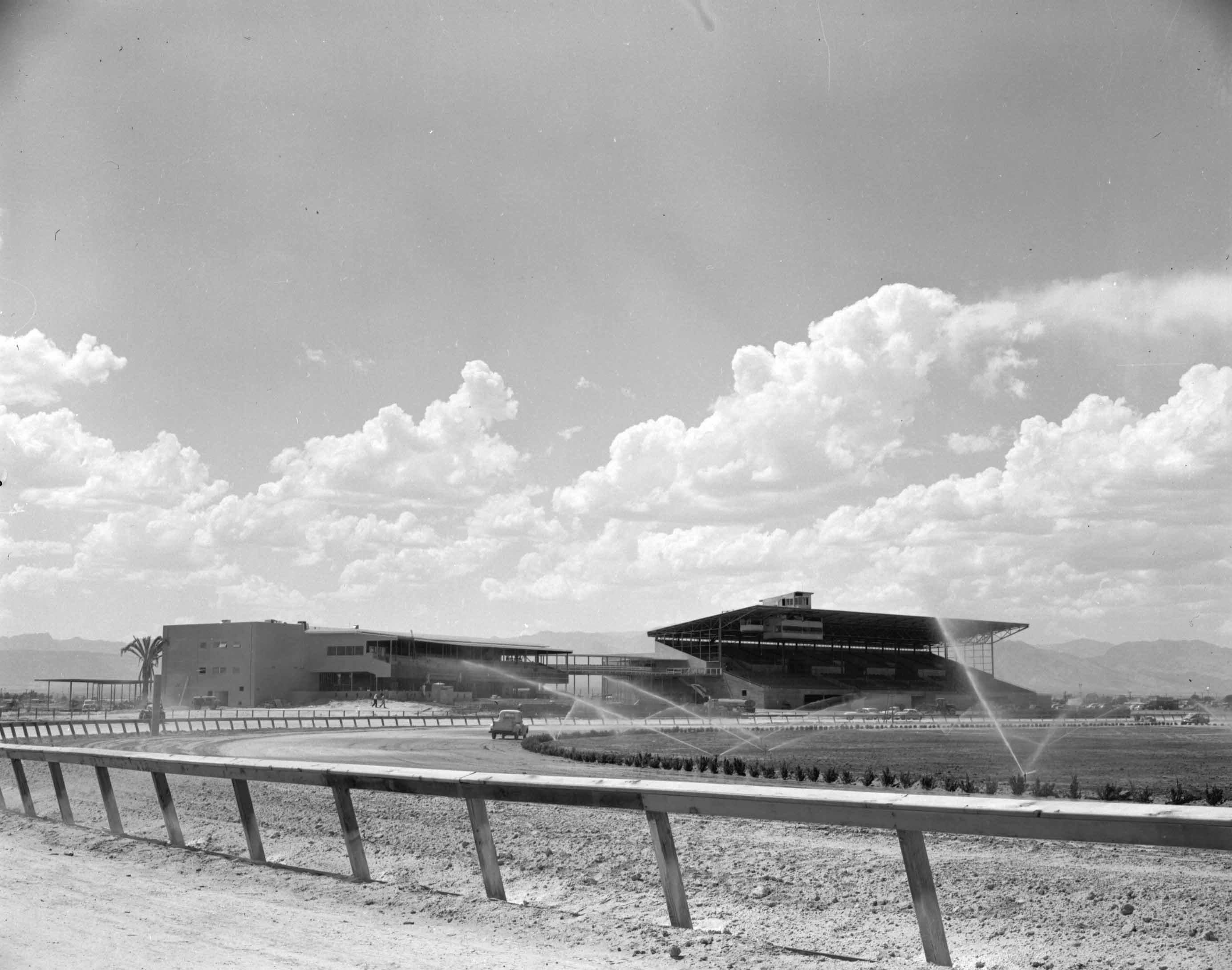 The Las Vegas track during construction in 1951. The clubhouse and grandstands appear largely complete, but the inside rail has not been installed. The turf course, which was never used, is being watered. Photo: Las Vegas News Bureau