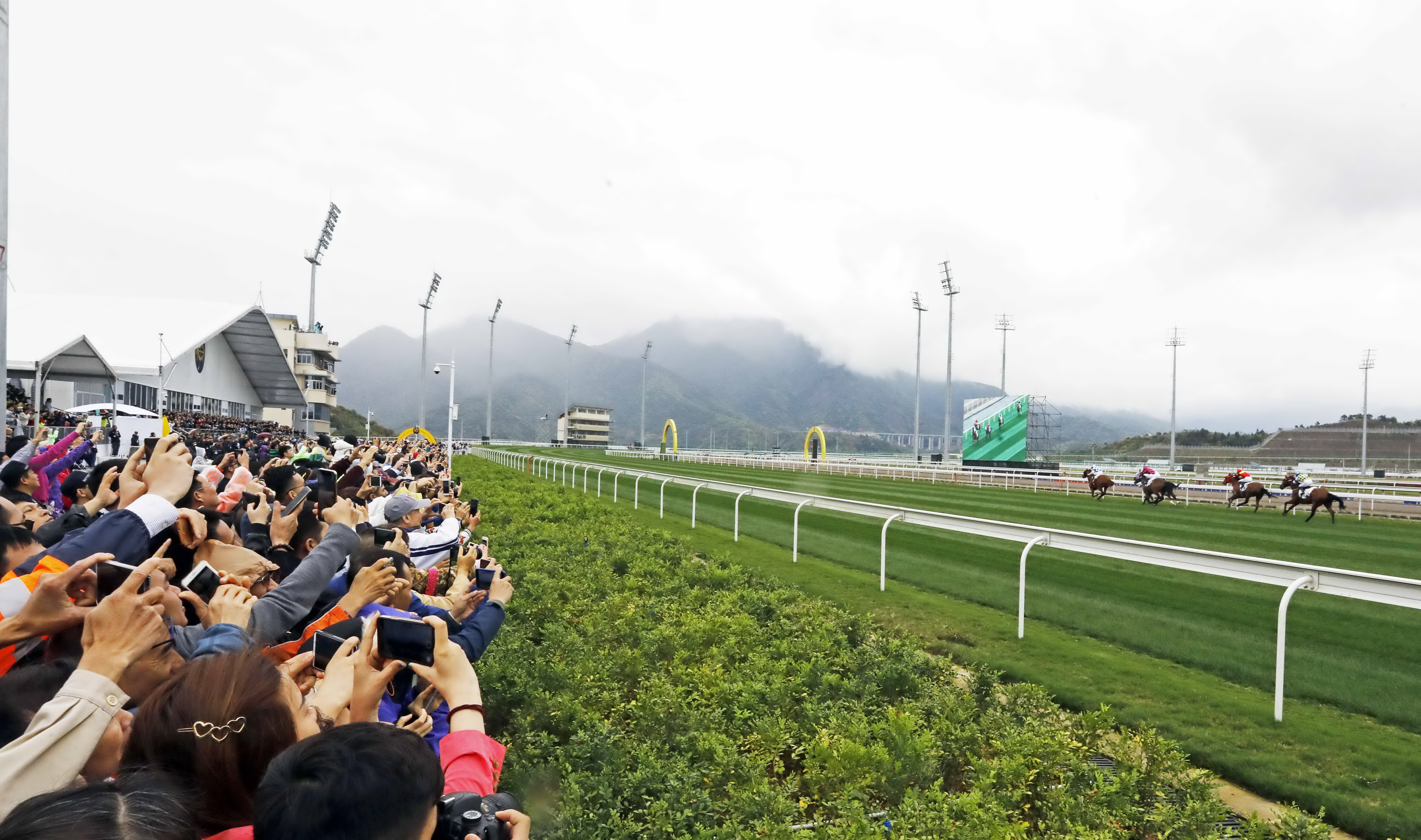 It was estimated that 95 per cent of the 3,500 crowd had never been racing before, but they certainly seemed engrossed by the action. Photo: Hong Kong Jockey Club