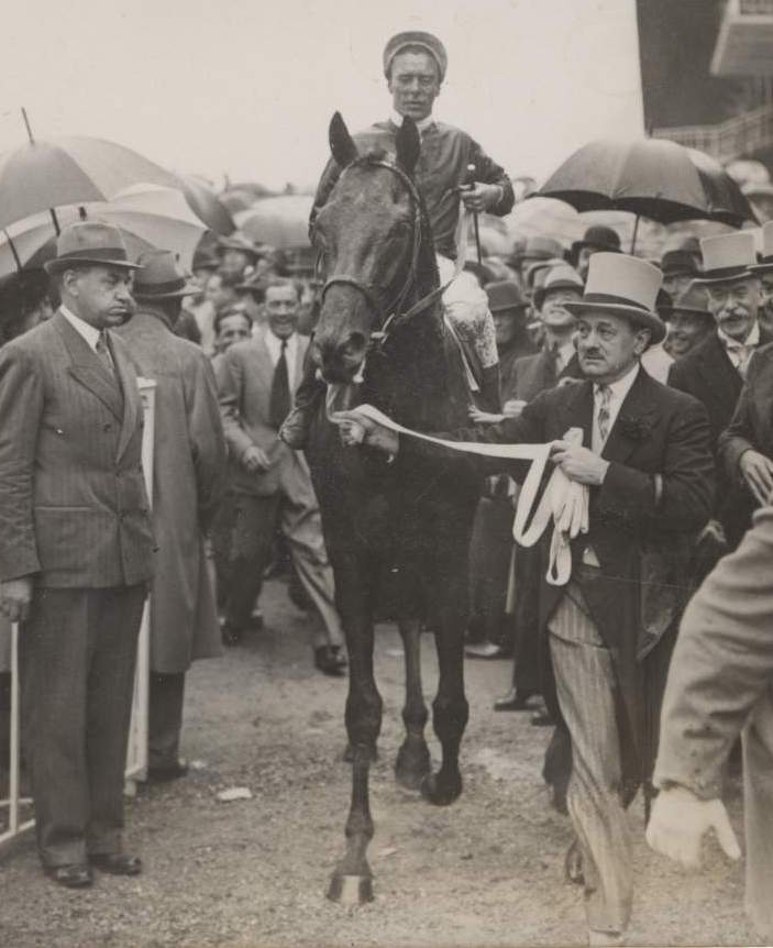 Pharis and Charlie Elliott being led in by Marcel Boussac after winning the Prix du Jockey Club in 1939