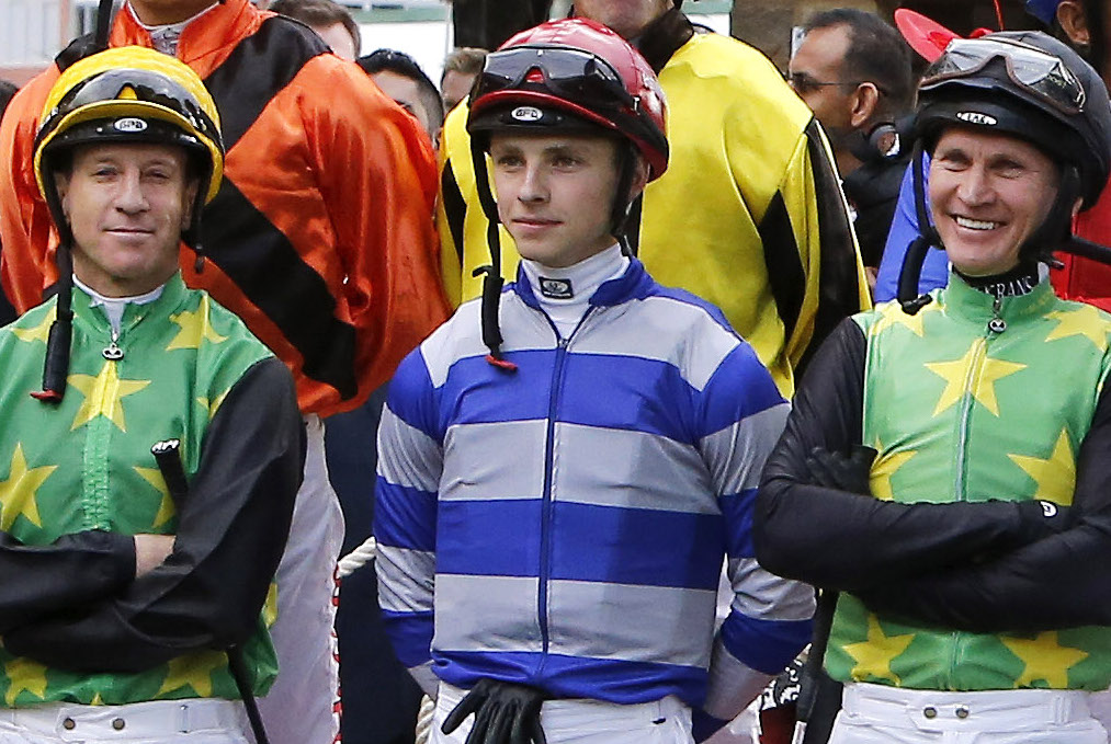Shoulder to shoulder: Lyle Hewitson, just 18 at the time, is flanked by former South African multiple champion jockeys Anton Marcus (left) and Pierre Strydom in a group photo taken before the 2016 Durban July (which Strydom won on The Conglomerate). Photo: Michele MacDonald