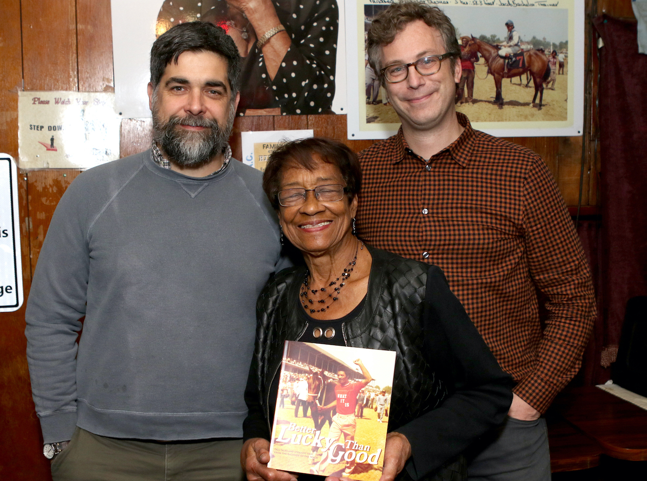 Ms Sylvia - and a copy of the new book - with Joe Manning (left), deputy director of the Louisville Story Program, and Darcy Thompson, executive director. Photo: George Williams